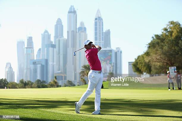 Rory McIlroy of Northern Ireland plays his second shot on the 13th hole during the second round of the Omega Dubai Desert Classic at the Emirates...
