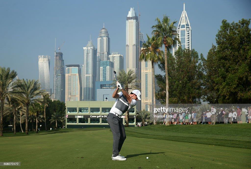 Rory McIlroy of Northern Ireland plays his second shot on the 16th hole during the first round of the Omega Dubai Desert Classic at The Emirates Golf Club on February 4, 2016 in Dubai, United Arab Emirates.