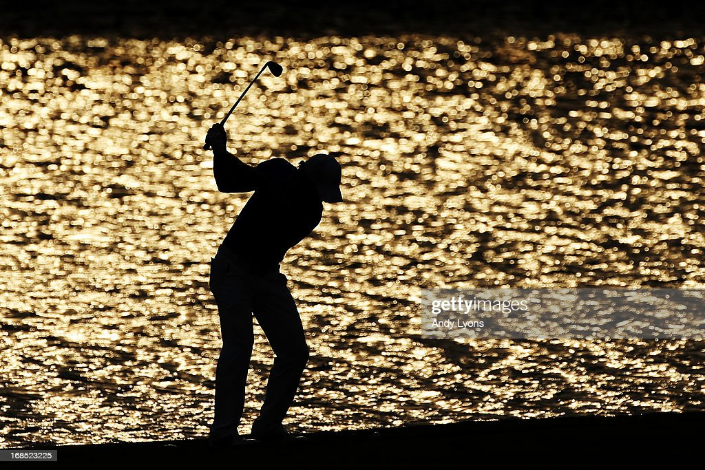 Rory McIlroy of Northern Ireland plays his second shot on the 18th hole during round two of THE PLAYERS Championship at THE PLAYERS Stadium course at TPC Sawgrass on May 10, 2013 in Ponte Vedra Beach, Florida.