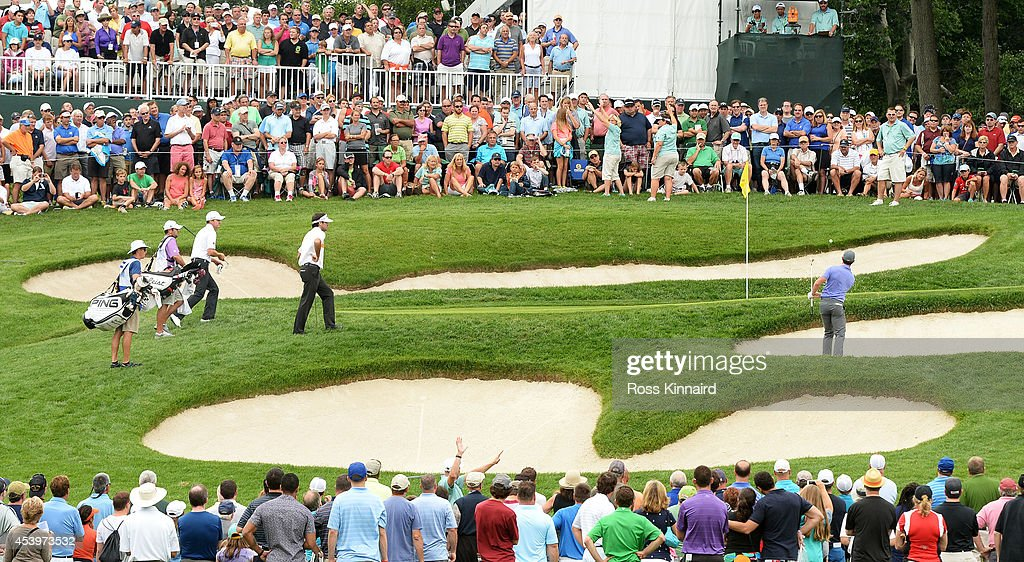<a gi-track='captionPersonalityLinkClicked' href=/galleries/search?phrase=Rory+McIlroy&family=editorial&specificpeople=783109 ng-click='$event.stopPropagation()'>Rory McIlroy</a> of Northern Ireland plays his second shot on the fifth hole during the second round of The Barclays at The Ridgewood Country Club on August 22, 2014 in Paramus, New Jersey.