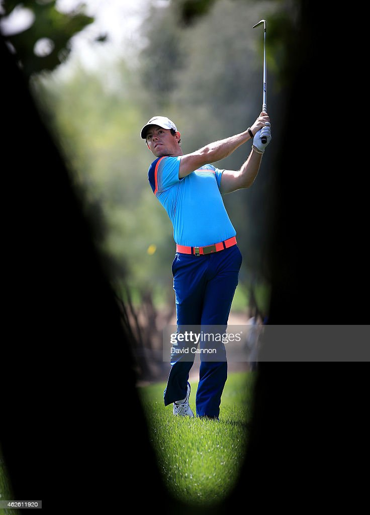 Rory McIlroy of Northern Ireland plays his second shot on the par 4 first hole during the final round of the 2015 Omega Dubai Desert Classic on the...