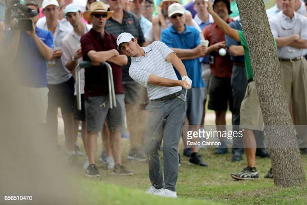 Rory McIlroy of Northern Ireland plays his second shot on the par 4 first hole in his match against Soren Kjeldsen of Denmark during the first round...