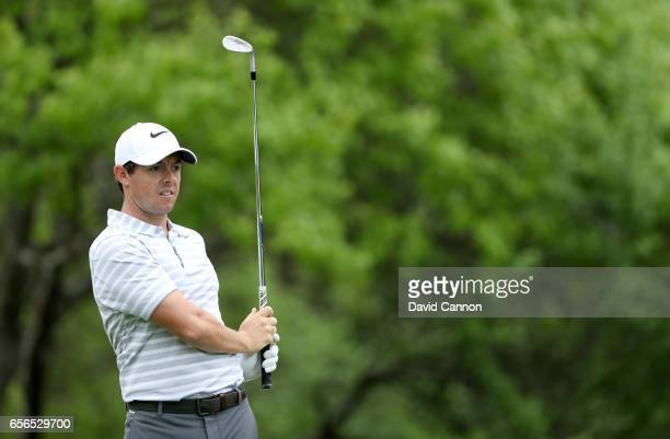 Rory McIlroy of Northern Ireland plays his second shot on the par 4 third hole in his match against Soren Kjeldsen of Denmark during the first round...