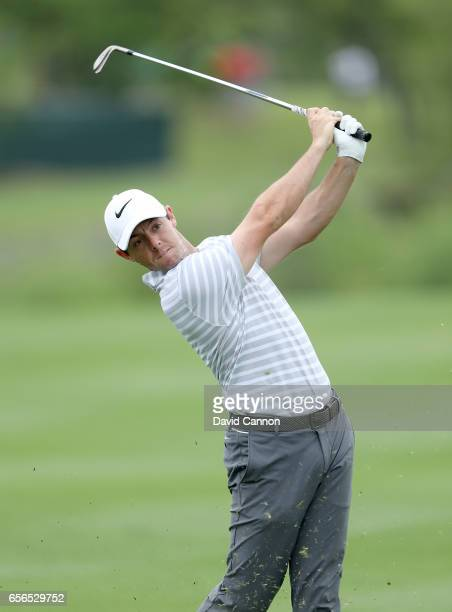 Rory McIlroy of Northern Ireland plays his second shot on the par 4 second hole in his match against Soren Kjeldsen of Denmark during the first round...