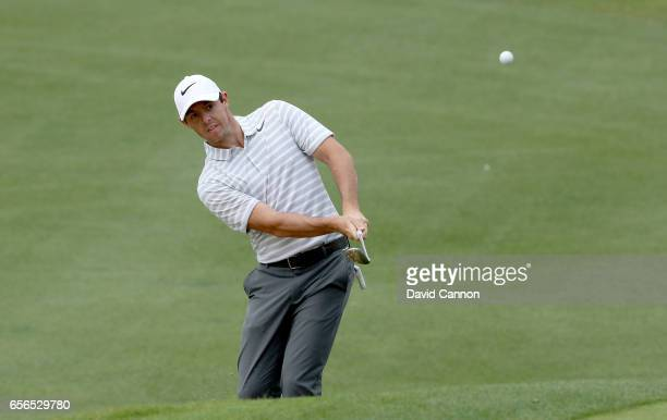 Rory McIlroy of Northern Ireland plays his second shot on the par 4 fifth hole in his match against Soren Kjeldsen of Denmark during the first round...