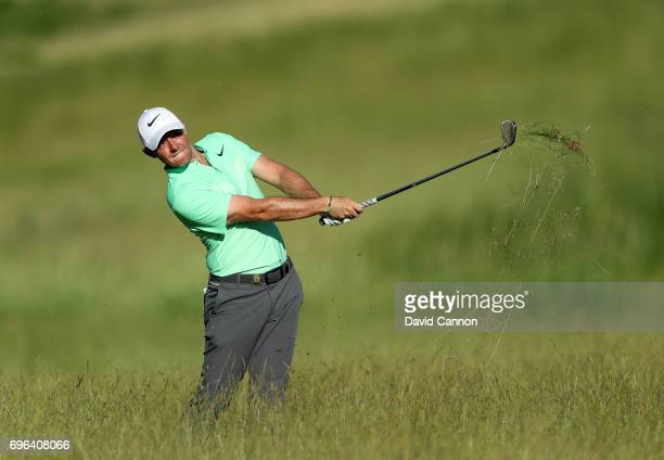 Rory McIlroy of Northern Ireland plays his second shot on the par 4 15th hole during the first round of the 117th US Open Championship at Erin Hills...