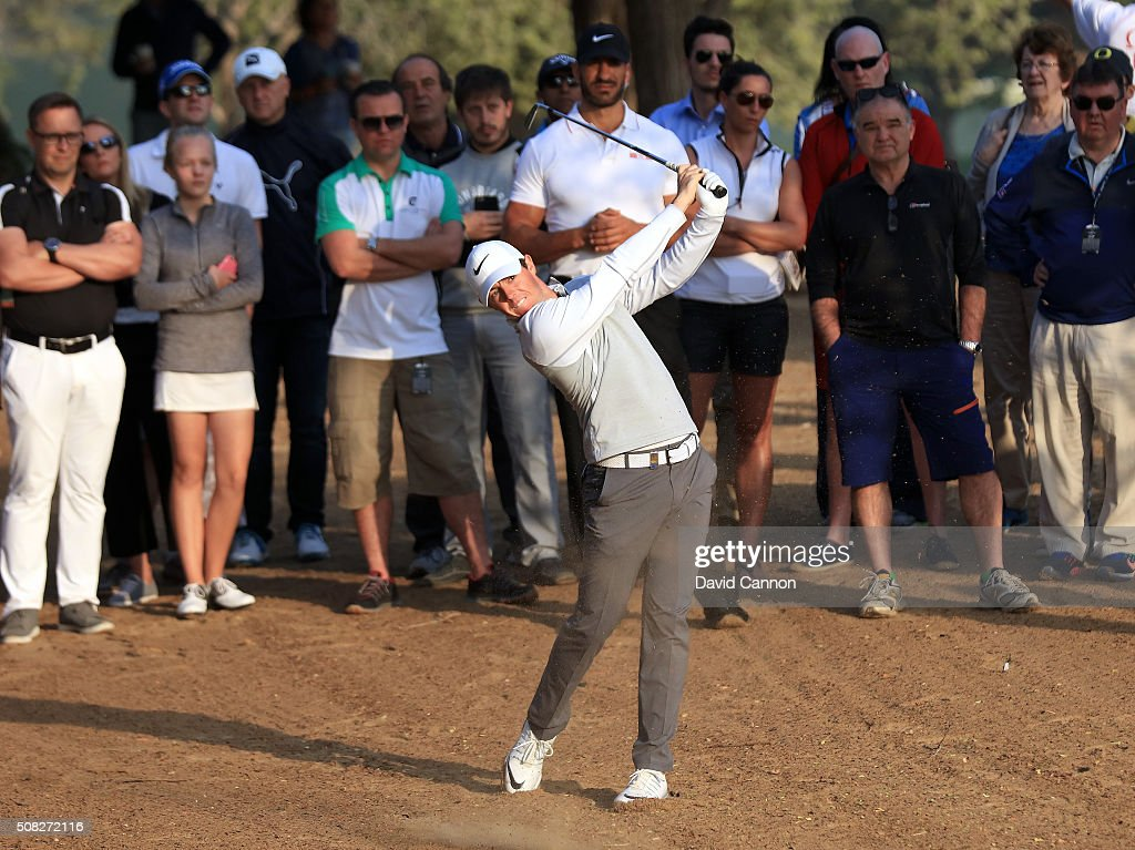 Rory McIlroy of Northern Ireland plays his second shot on the par 5 10th hole during the first round of the 2016 Omega Dubai Desert Classic on the...
