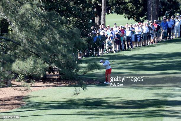 Rory McIlroy of Northern Ireland plays his second shot on the tenth hole during the third round of the 2017 Masters Tournament at Augusta National...