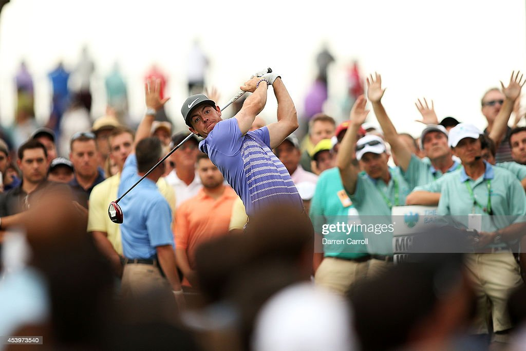 <a gi-track='captionPersonalityLinkClicked' href=/galleries/search?phrase=Rory+McIlroy&family=editorial&specificpeople=783109 ng-click='$event.stopPropagation()'>Rory McIlroy</a> of Northern Ireland plays his shot from the 13th tee during the second round of The Barclays at The Ridgewood Country Club on August 22, 2014 in Paramus, New Jersey.