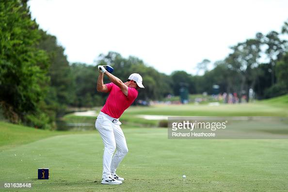 Rory McIlroy of Northern Ireland plays his shot from the 14th tee during the final round of THE PLAYERS Championship at the Stadium course at TPC...