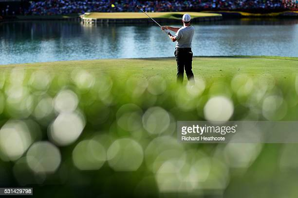 Rory McIlroy of Northern Ireland plays his shot from the 17th tee during the third round of THE PLAYERS Championship at the Stadium course at TPC...