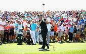 Rory McIlroy of Northern Ireland plays his shot from the 18th tee during round one of THE PLAYERS Championship at the TPC Sawgrass Stadium course on...