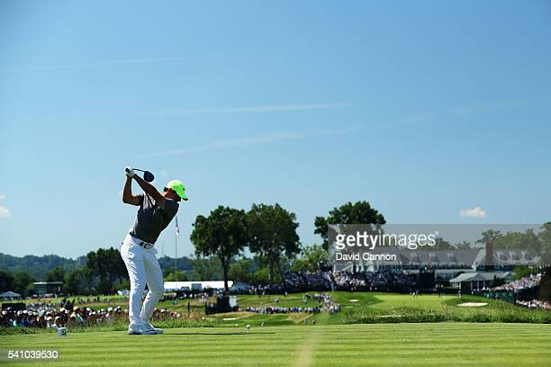 Rory McIlroy of Northern Ireland plays his shot from the 18th tee during the continuation of the second round of the US Open at Oakmont Country Club...