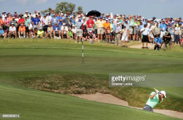 Rory McIlroy of Northern Ireland plays his shot from the bunker on the eighth hole during the first round of the 2017 US Open at Erin Hills on June...