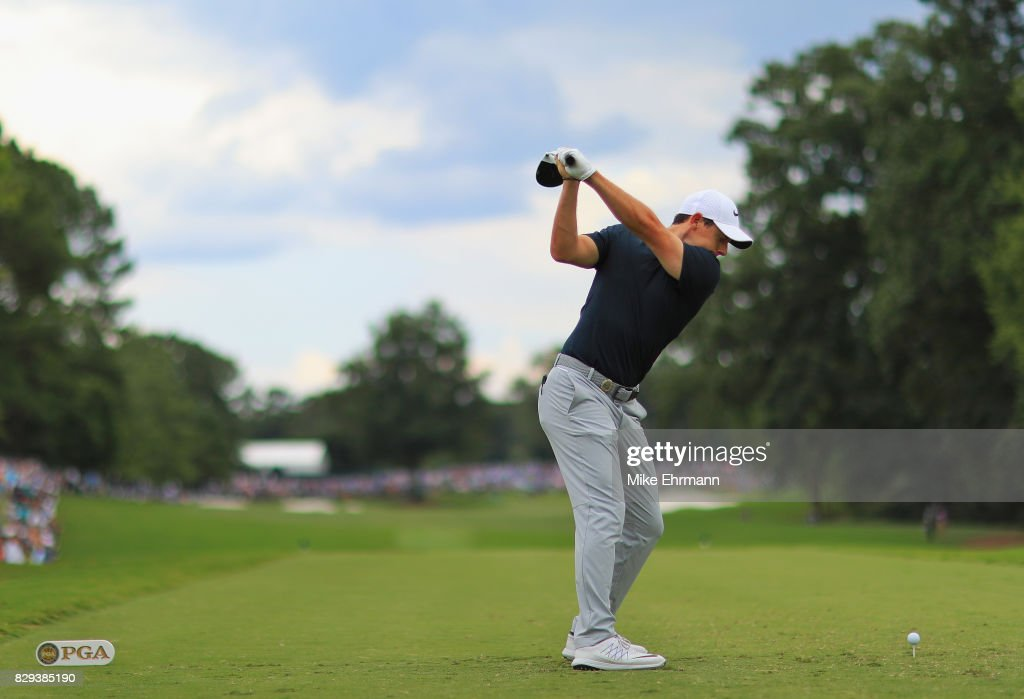 Rory McIlroy of Northern Ireland plays his shot from the eighth tee during the first round of the 2017 PGA Championship at Quail Hollow Club on August 10, 2017 in Charlotte, North Carolina.
