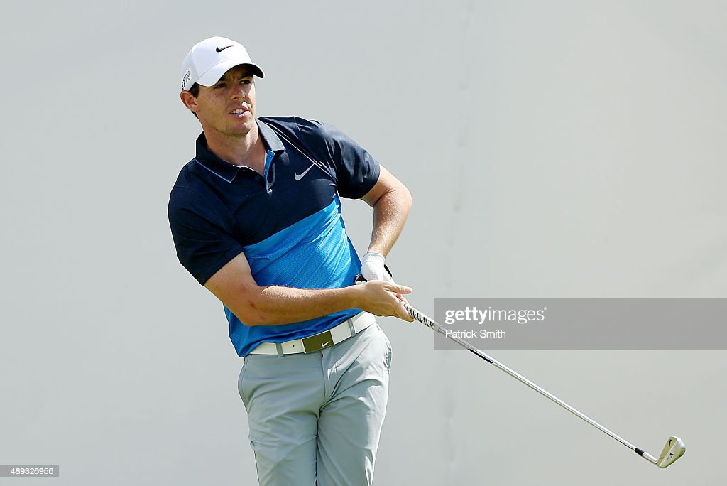 Rory McIlroy of Northern Ireland plays his shot from the first tee during the Final Round of the BMW Championship at Conway Farms Golf Club on...