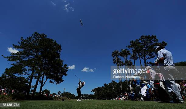 Rory McIlroy of Northern Ireland plays his shot from the seventh tee during the third round of THE PLAYERS Championship at the Stadium course at TPC...