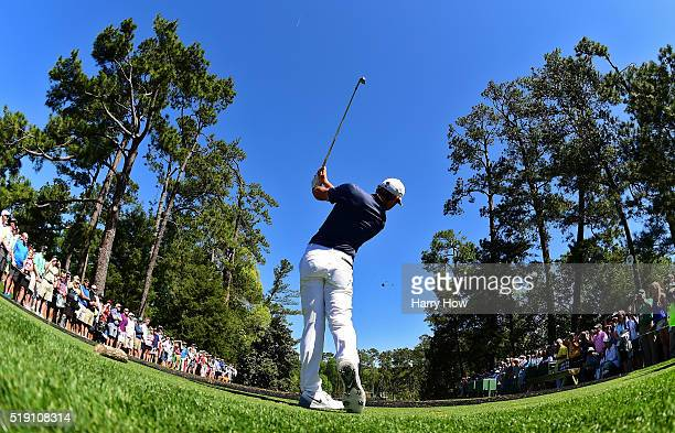 Rory McIlroy of Northern Ireland plays his shot from the sixth tee during a practice round prior to the start of the 2016 Masters Tournament at...