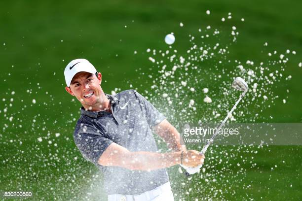 Rory McIlroy of Northern Ireland plays his shot out of the bunker on the first hole during the second round of the 2017 PGA Championship at Quail...