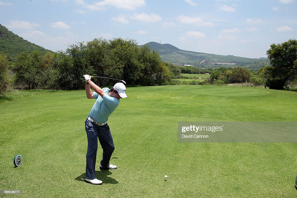 <a gi-track='captionPersonalityLinkClicked' href=/galleries/search?phrase=Rory+McIlroy&family=editorial&specificpeople=783109 ng-click='$event.stopPropagation()'>Rory McIlroy</a> of Northern Ireland plays his tee shot at the 14th hole during the pro-am as a preview for the 2009 Nedbank Golf Challenge at the Gary Player Country Club Course on December 2, 2009 in Sun City, South Africa.
