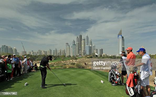 Rory McIlroy of Northern Ireland plays his tee shot at the par 4 8th hole during the second round of the 2012 Omega Dubai Desert Classic on the...