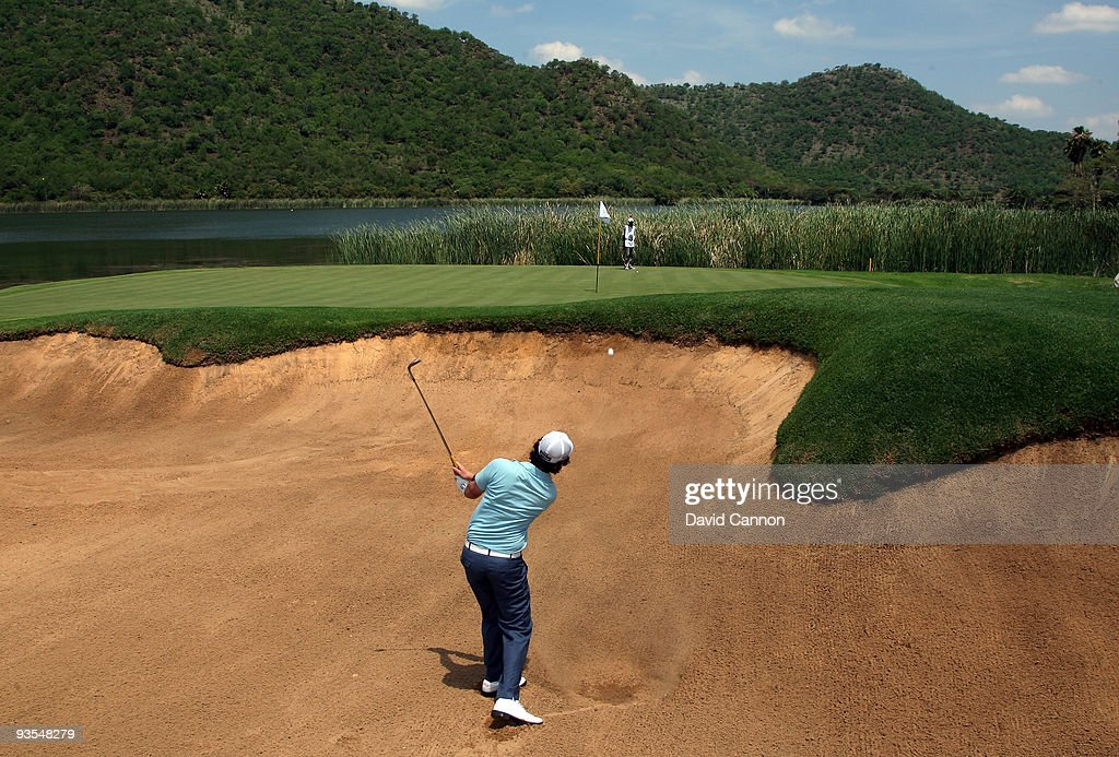 <a gi-track='captionPersonalityLinkClicked' href=/galleries/search?phrase=Rory+McIlroy&family=editorial&specificpeople=783109 ng-click='$event.stopPropagation()'>Rory McIlroy</a> of Northern Ireland plays his third shot at the 17th hole during the pro-am as a preview for the 2009 Nedbank Golf Challenge at the Gary Player Country Club Course on December 2, 2009 in Sun City, South Africa.