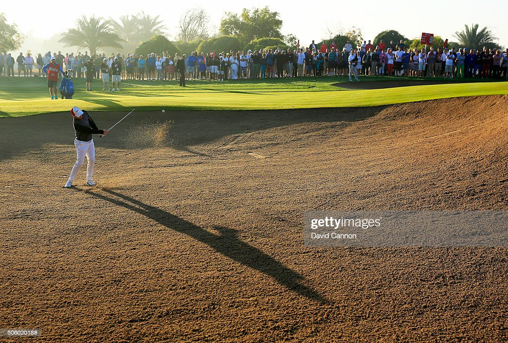 Rory McIlroy of Northern Ireland plays his third shot at the par 5, 10th hole during the first round of the 2016 Abu Dhabi HSBC Golf Championship at the Abu Dhabi Golf Club on January 21, 2016 in Abu Dhabi, United Arab Emirates.