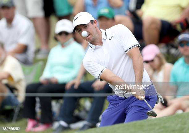 Rory McIlroy of Northern Ireland plays his third shot on the par 5 16th hole during the third round of the THE PLAYERS Championship on the Stadium...