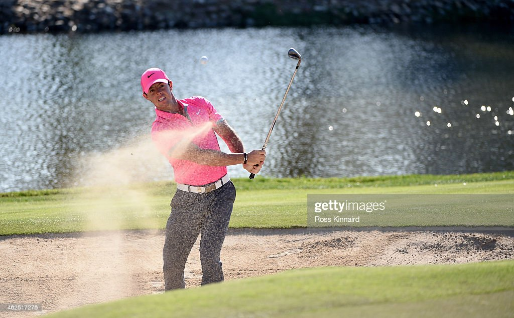 Rory McIlroy of Northern Ireland plays his third shot on the par five 13th hole during the second round of the Omega Dubai Desert Classic at the...