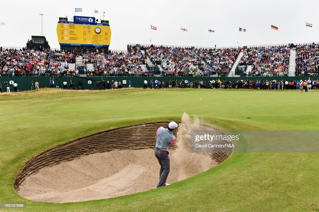 <a gi-track='captionPersonalityLinkClicked' href=/galleries/search?phrase=Rory+McIlroy&family=editorial&specificpeople=783109 ng-click='$event.stopPropagation()'>Rory McIlroy</a> of Northern Ireland plays his third shot out of the bunker on the 18th hole during the final round of The 143rd Open Championship at Royal Liverpool on July 20, 2014 in Hoylake, England.