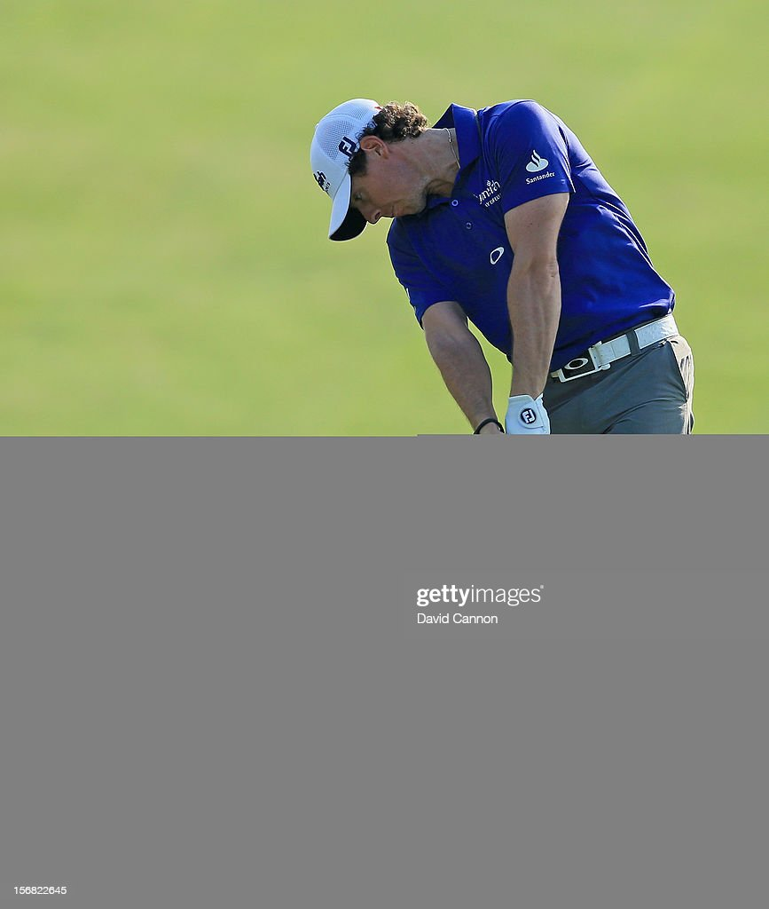 Rory McIlroy of Northern Ireland plays his third shot to the par 5, 18th hole during the first round of the 2012 DP World Tour Championship on the Earth Course at Jumeirah Golf Estates on November 22, 2012 in Dubai, United Arab Emirates.