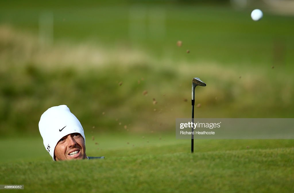 Rory McIlroy of Northern Ireland plays out from the road hole bunker on the 17th green during the final round of the 2014 Alfred Dunhill Links Championship at The Old Course on October 5, 2014 in St Andrews, Scotland.