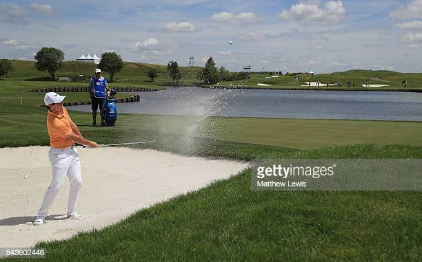 Rory McIlroy of Northern Ireland plays out of a bunker during a proam round ahead of the 100th Open de France at Le Golf National on June 29 2016 in...