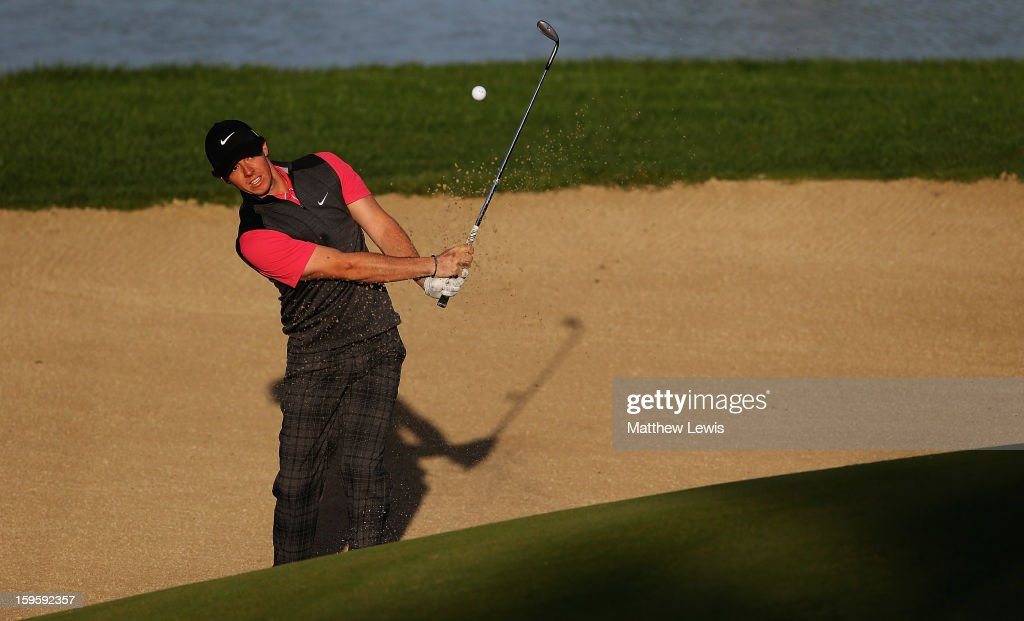 Rory McIlroy of Northern Ireland plays out of a bunker on the 12th hole during day one of the Abu Dhabi HSBC Golf Championship at Abu Dhabi Golf Club on January 17, 2013 in Abu Dhabi, United Arab Emirates.