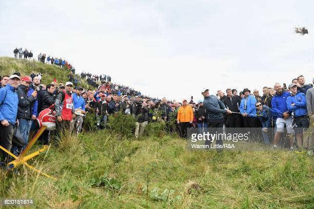 Rory McIlroy of Northern Ireland plays out of the rough on the 15th hole during the second round of the 146th Open Championship at Royal Birkdale on...