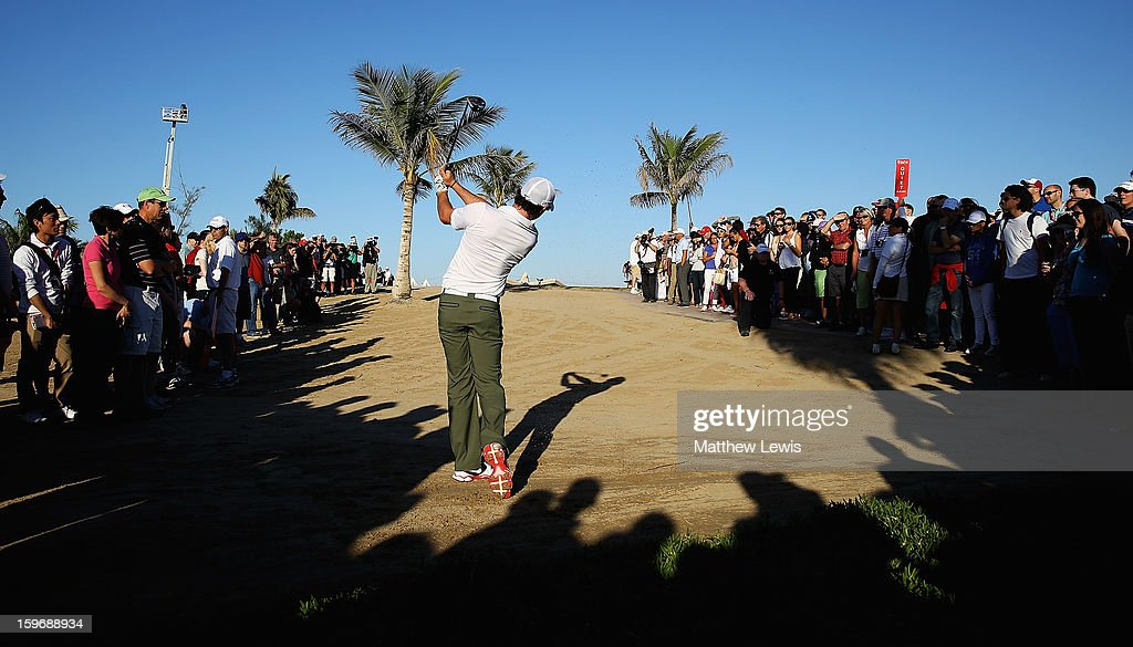 Rory McIlroy of Northern Ireland plays out of the rough on the 18th hole during day two of the Abu Dhabi HSBC Golf Championship at Abu Dhabi Golf Club on January 18, 2013 in Abu Dhabi, United Arab Emirates.