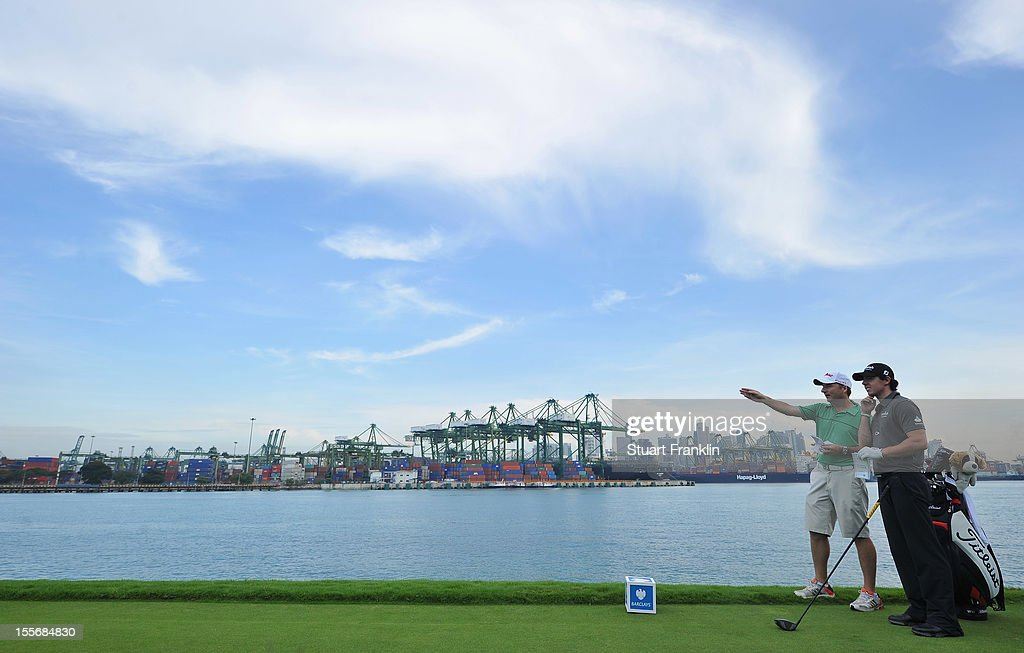 <a gi-track='captionPersonalityLinkClicked' href=/galleries/search?phrase=Rory+McIlroy&family=editorial&specificpeople=783109 ng-click='$event.stopPropagation()'>Rory McIlroy</a> of Northern Ireland ponders his club selection with caddie J.P Fritzgerald, as he leans on his Titleist bag during the pro - am prior to the start of the Barclays Singapore Open at the Sentosa Golf Club on November 7, 2012 in Singapore.
