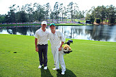 Rory McIlroy of Northern Ireland poses alongside his caddie Niall Horan of the band One Direction during the Par 3 Contest prior to the start of the...
