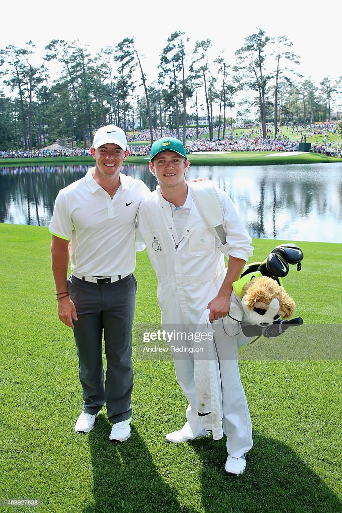 Rory McIlroy of Northern Ireland poses alongside his caddie Niall Horan of the band One Direction during the Par 3 Contest prior to the start of the 2015 Masters Tournament at Augusta National Golf Club on April 8, 2015 in Augusta, Georgia.