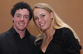 Rory McIlroy of Northern Ireland poses alongside his girlfriend Caroline Wozniacki of Denmark during the Welcome Reception at the Waitanyuan prior to...