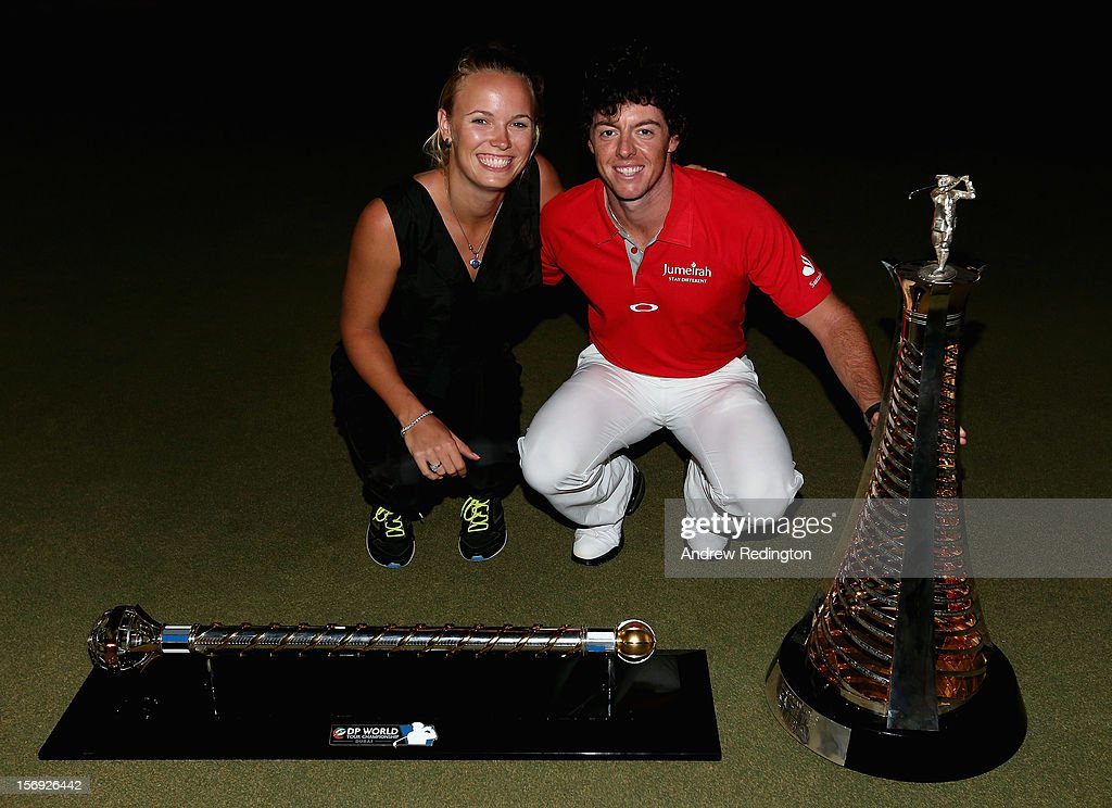 Rory McIlroy of Northern Ireland poses alongside his girlfriend Caroline Wozniacki with both the Race To Dubai and DP World Tour Championship trophies after winning the DP World Tour Championship on the Earth Course at Jumeirah Golf Estates on November 25, 2012 in Dubai, United Arab Emirates.
