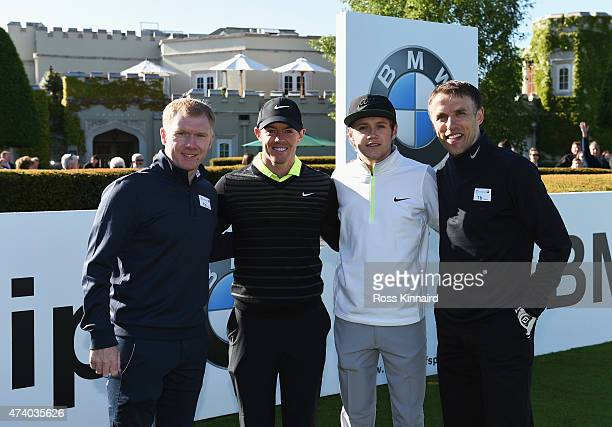 Rory McIlroy of Northern Ireland poses with former Manchester United footballers Paul Scholes and Phil Neville and Niall Horan of One Direction...