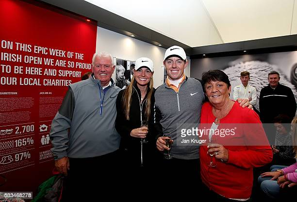 Rory McIlroy of Northern Ireland poses with his father Gerry mother Rosie and fiance Erica Stoll after victory in the final round of the final round...