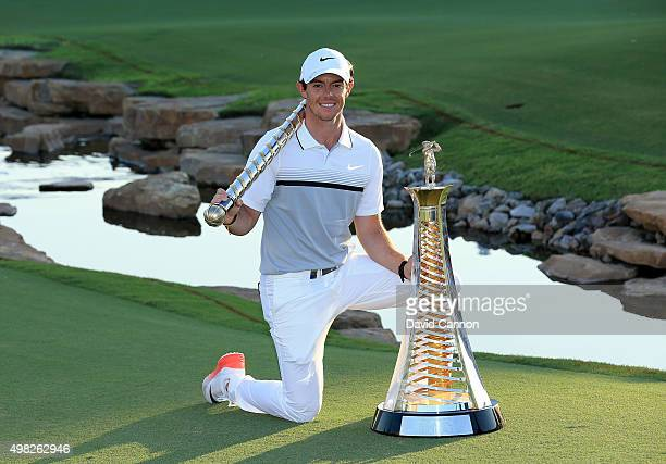 Rory McIlroy of Northern Ireland poses with The DP World Tour Championship and the Race to Dubai trophy after his one shot win in the final round of...