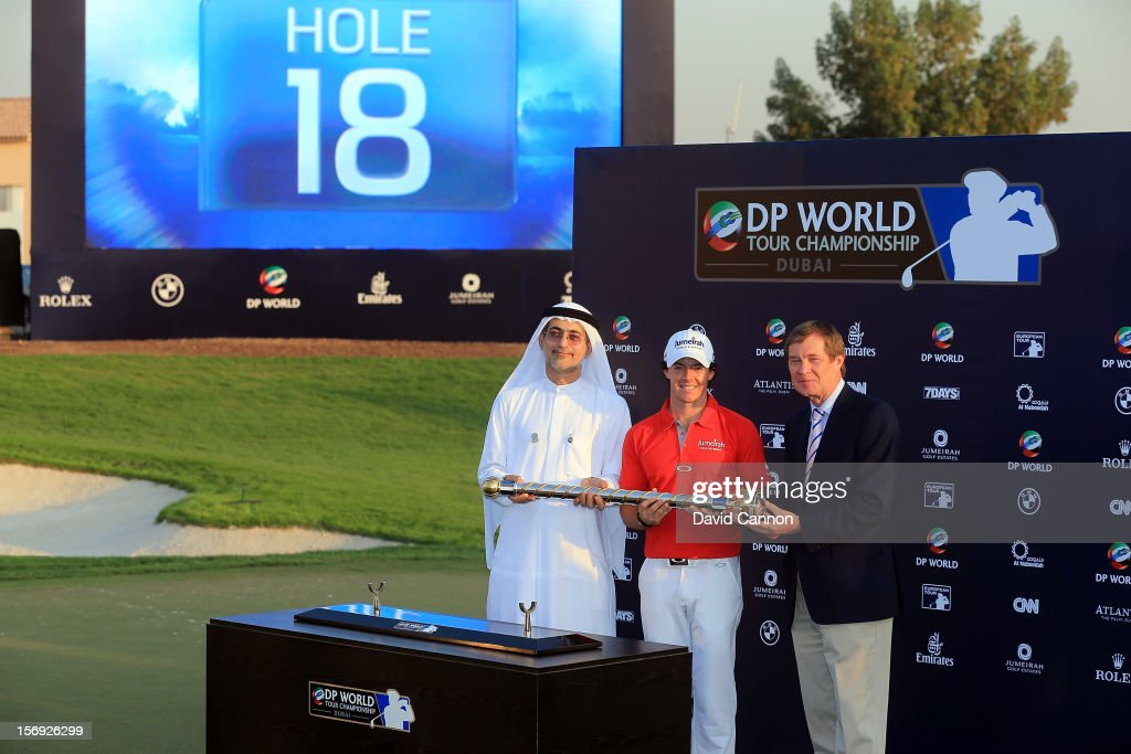 Rory McIlroy of Northern Ireland (centre) poses with the DP World Tour Championship trophy alongside Mohammed Sharaf ,Group CEO DP World, (left) and George O'Grady, Chief Executive of The European Tour, (right) during the final round of the 2012 DP World Tour Championship on the Earth Course at Jumeirah Golf Estates on November 25, 2012 in Dubai, United Arab Emirates.