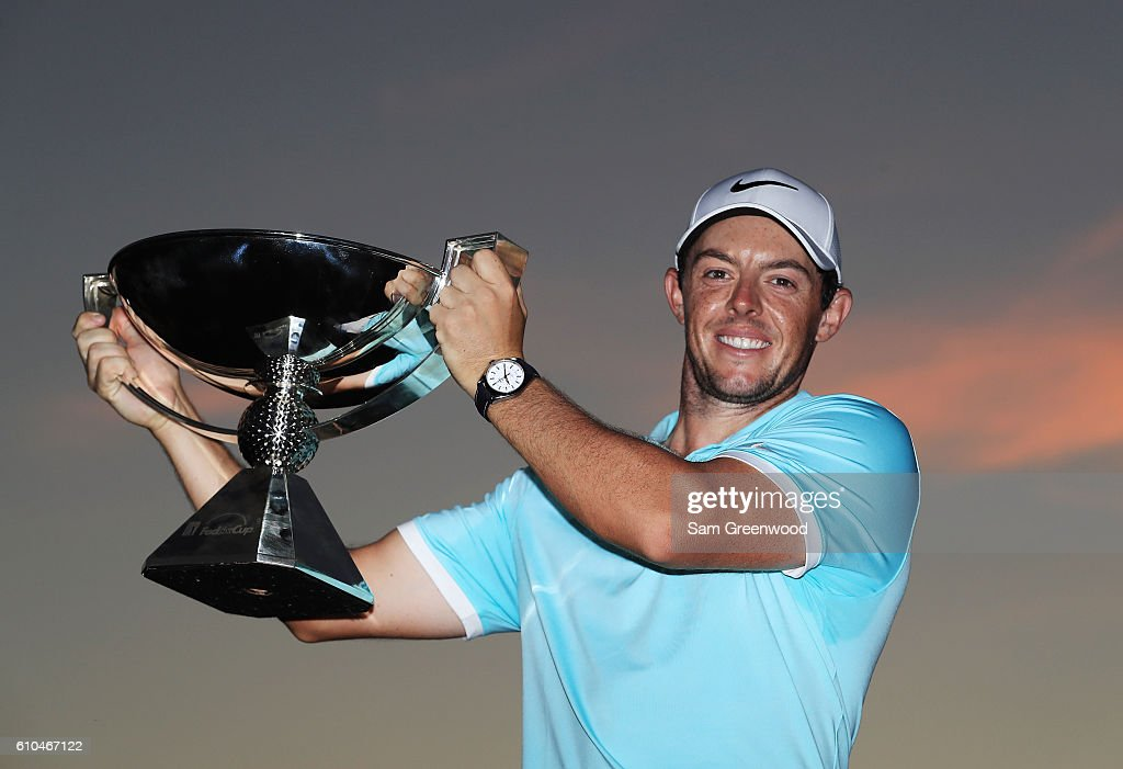 Rory McIlroy of Northern Ireland poses with the FedExCup after his victory over Ryan Moore with a birdie on the fourth extra hole during the TOUR Championship at East Lake Golf Club on September 25, 2016 in Atlanta, Georgia.