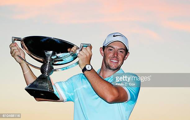 Rory McIlroy of Northern Ireland poses with the FedExCup after his victory over Ryan Moore with a birdie on the fourth extra hole during the TOUR...