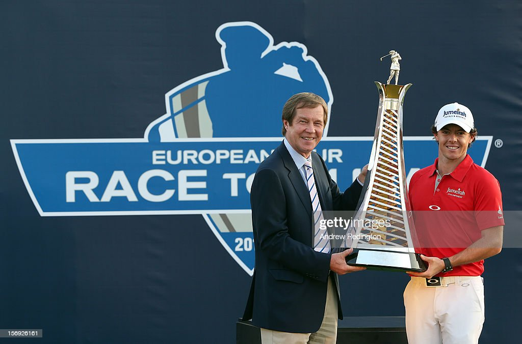 Rory McIlroy of Northern Ireland (R) poses with the Race To Dubai trophy next to George O'Grady, Chief Executive of The European Tour, after winning the DP World Tour Championship on the Earth Course at Jumeirah Golf Estates on November 25, 2012 in Dubai, United Arab Emirates.