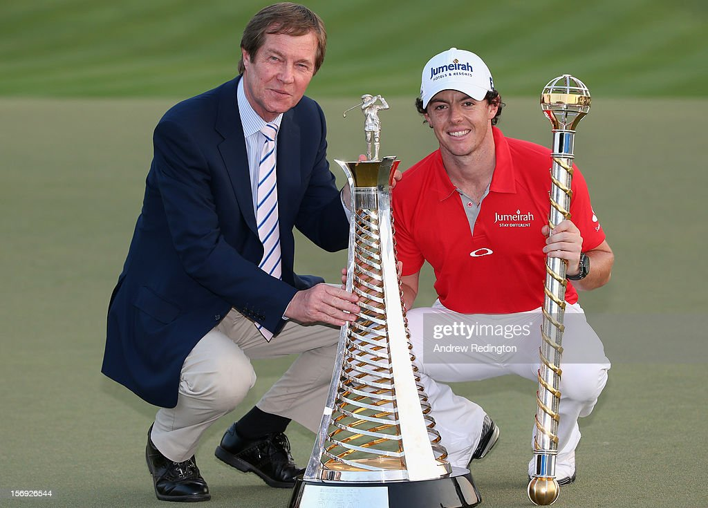 Rory McIlroy of Northern Ireland (R) poses with the Race To Dubai trophy and DP World Tour Championship trophy next to George O'Grady, Chief Executive of The European Tour, after winning the DP World Tour Championship on the Earth Course at Jumeirah Golf Estates on November 25, 2012 in Dubai, United Arab Emirates.