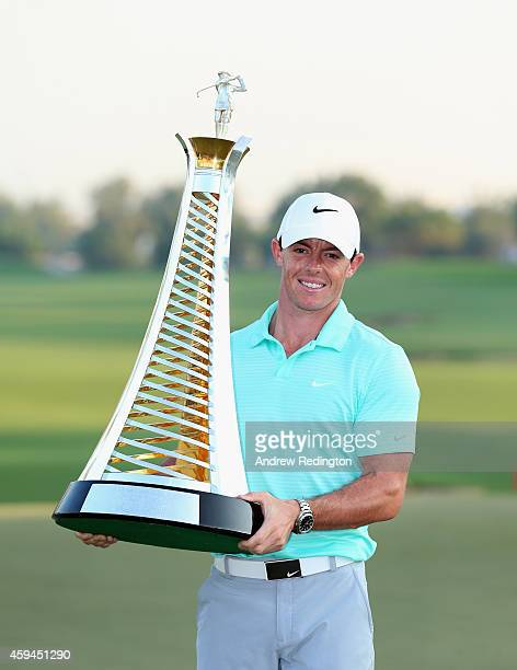 Rory McIlroy of Northern Ireland poses with the Race To Dubai trophy after winnng The Race To Dubai at the DP World Tour Championship at Jumeirah...